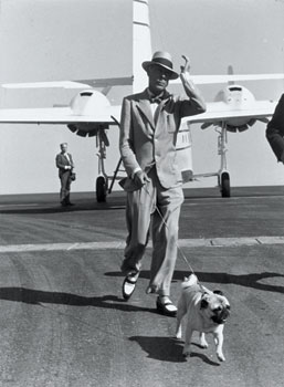 The Duke of Windsor arriving in the Riviera, complete with a fashionable Panama hat, correspondent shoes, and pug (early 1950s). Here we see the lounge suit as the ultimate expression of comfort and ease